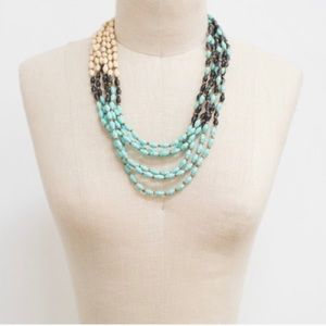 Turquoise/green, ivory and black beaded necklace